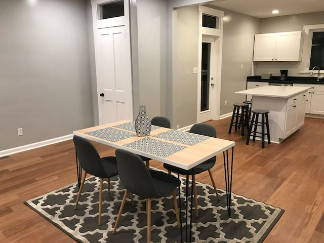 Open concept dining room and kitchen with half bath
