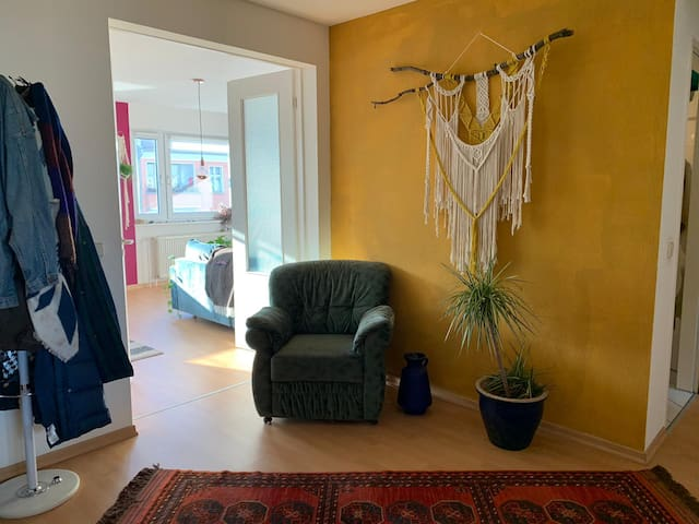 Light-filled room in colorful new two-bedroom