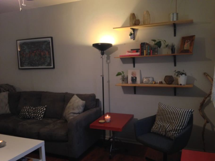 Living area with large sectional couch and extra seating