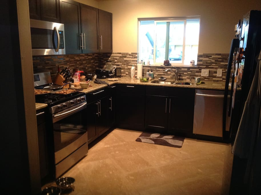 Great kitchen to entertain and enjoy a meal. Newly remodeled. Gas stove, microwave, full fridge.