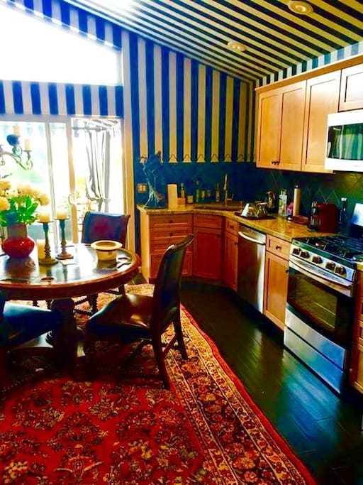 Designer kitchen and dining area - valuable oriental rugs