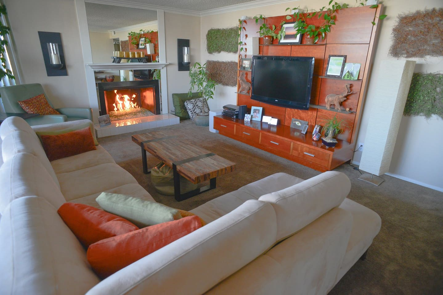 A warm and cozy living-room with fireplace, large screen LED TV, Bose stereo and surround sound