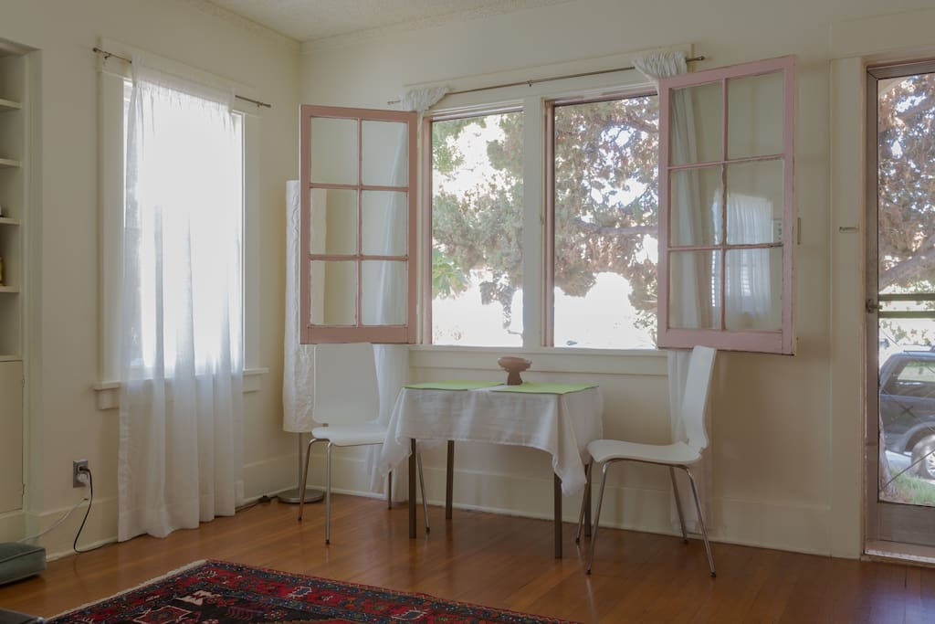 Living room with small dining table, french windows and front door