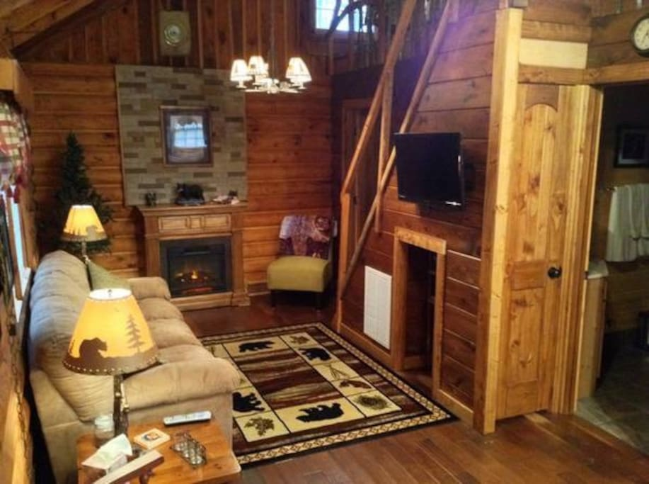 Cabin living room with fireplace and flat screen tv
