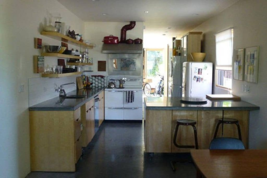 fully appointed kitchen with juicer, blender, processor, dishwasher, etc and all basic necessities/spicesfor cooking.