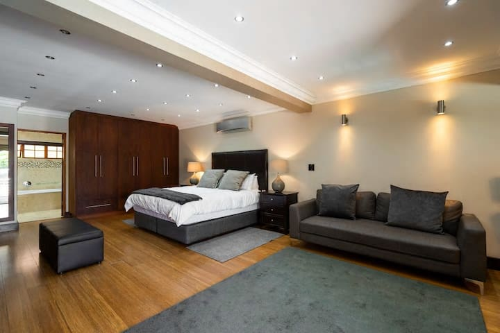 Downstairs master bedroom, en-suite bathroom and private lounge area