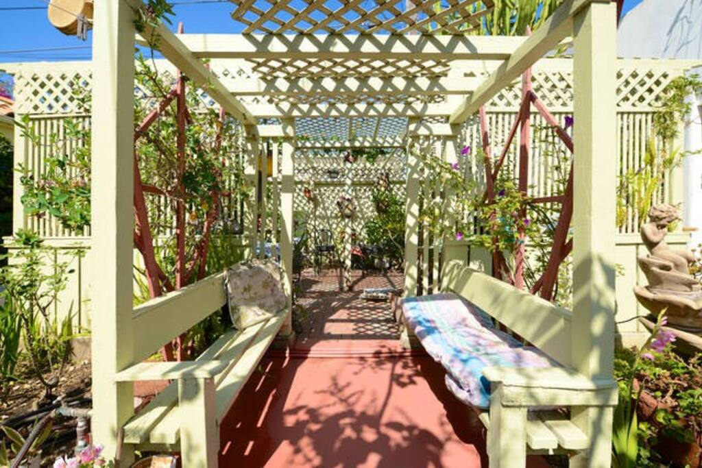 Entry to lath house w/orchids, shade plants; available to guests