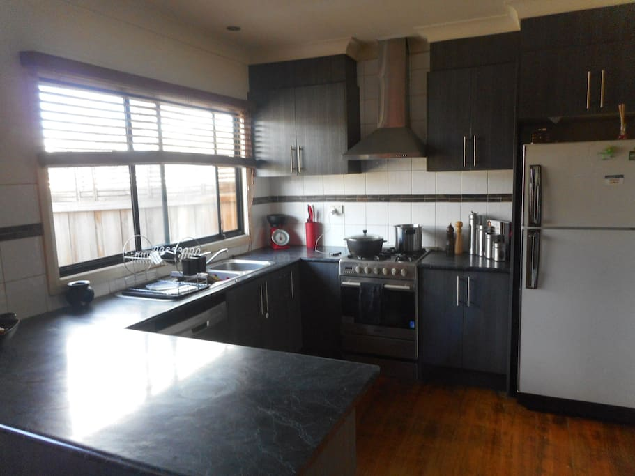 Nice modern kitchen with dishwasher and gas appliances!