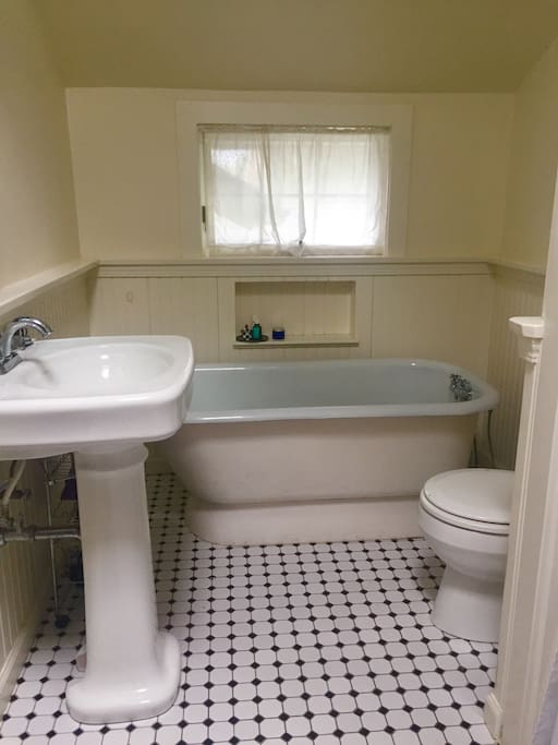Full bath with tub and separate shower.