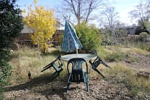 Front yard glass table and umbrella for breakfast or lunch outside dining?