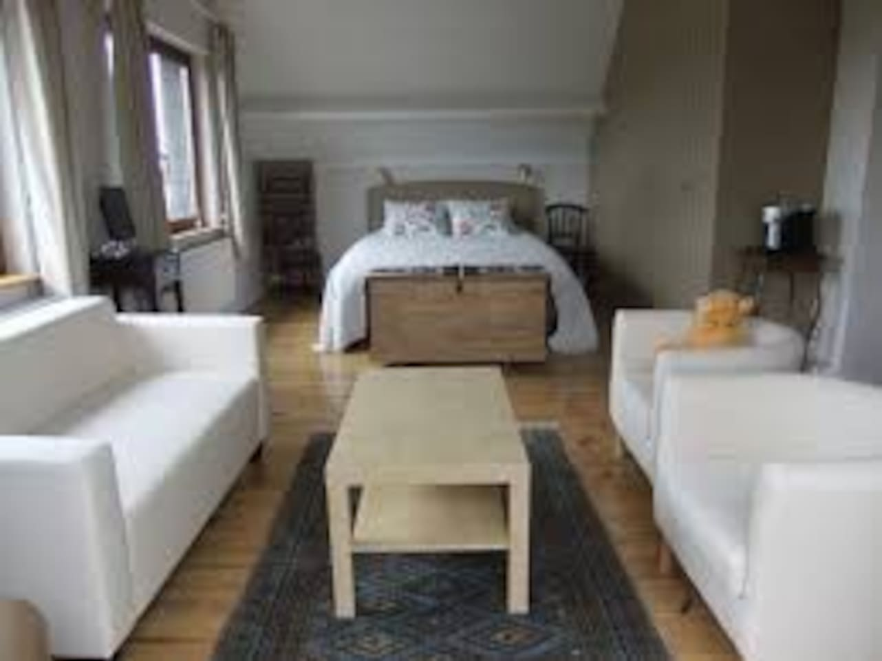 A spacious room with one double and two single beds, a sitting area with TV and beautiful views of the countryside.
