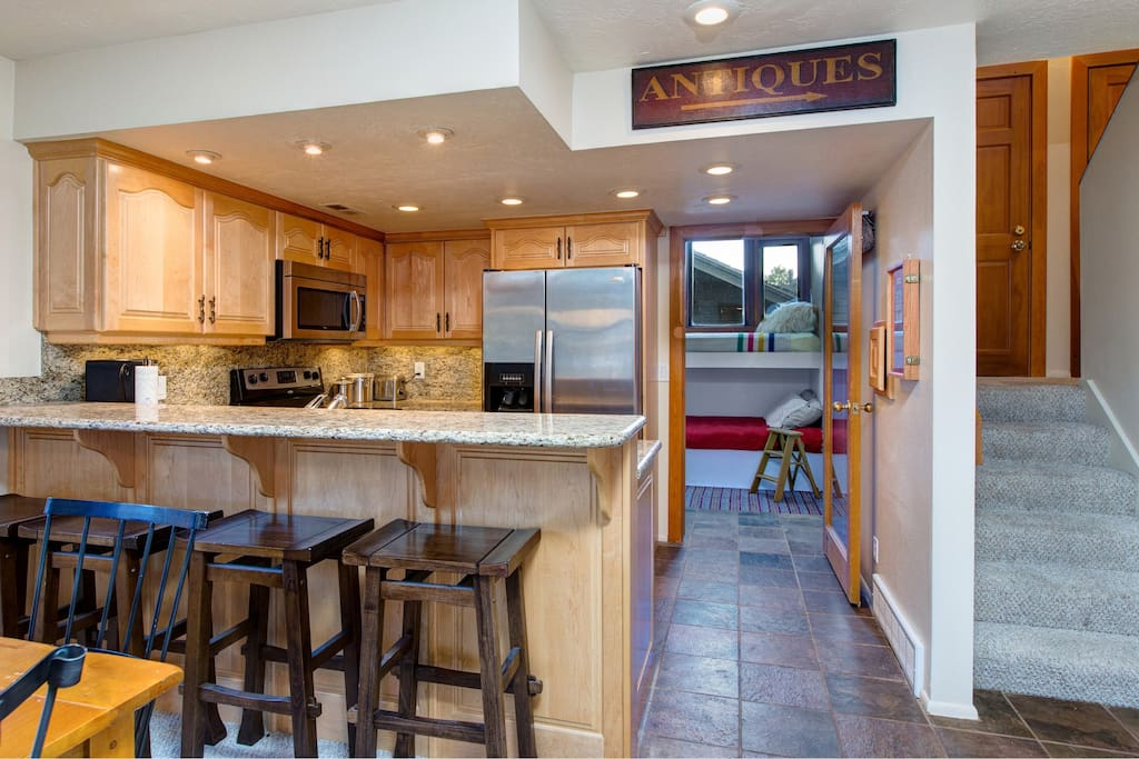 Fully equipped kitchen with stainless appliances and granite counters