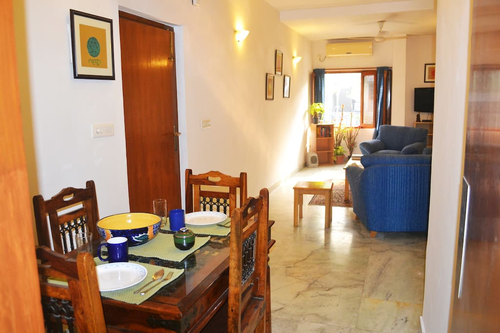 Dining Area + Living Room. Entrance to apartment via door on the left.