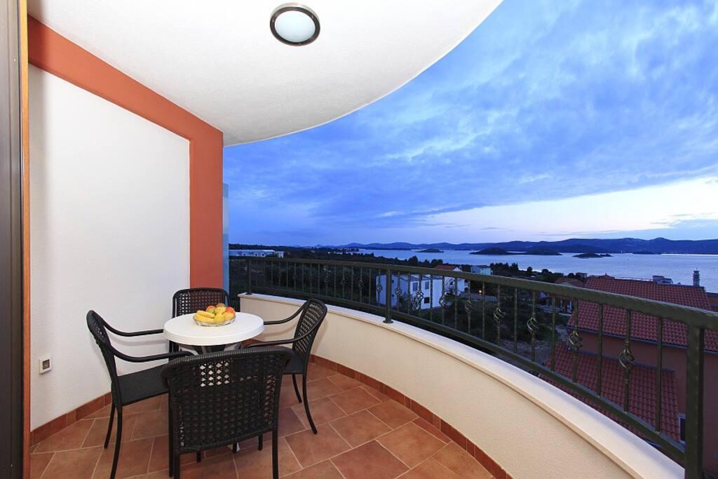 Balcony-view on heart shape Island Galešnjak