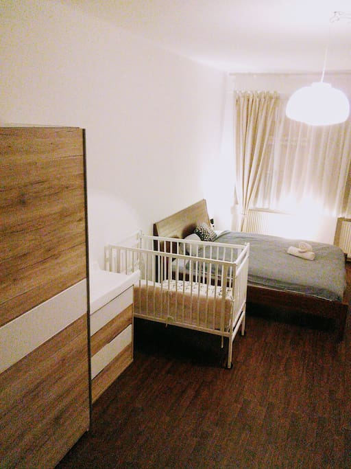 Bedroom with baby bed and furniture