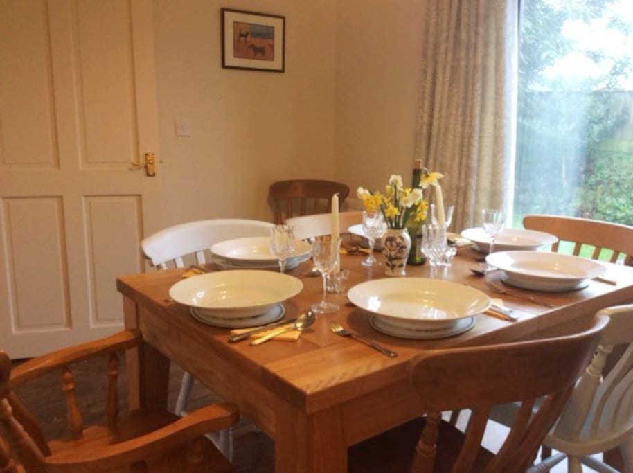 Open plan family dining room with leading to a small enclosed garden.