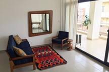 Living Room area. Floor to ceiling windows.