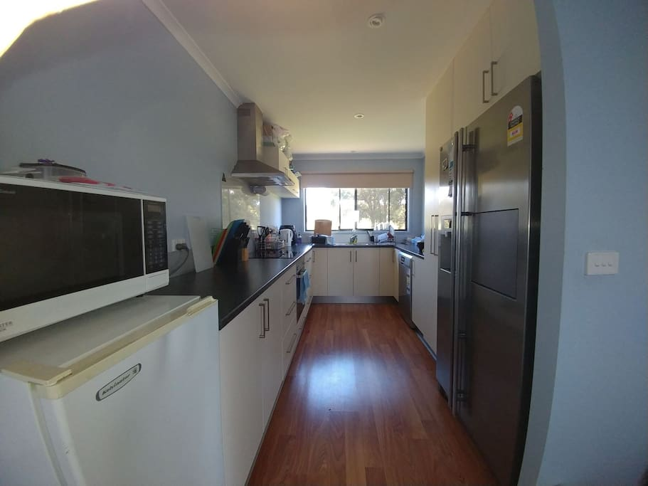 Kitchen with all cooking essentials. Guest freezer and supplied washing liquid, paper towel and dish washer.