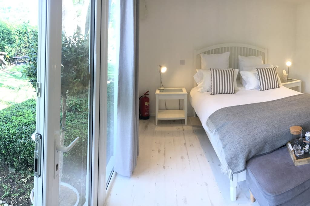 Luxury bedroom for two people. In a secluded garden with private access.