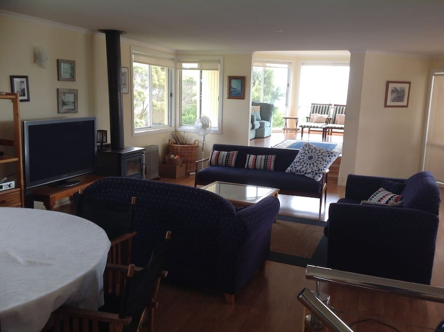 Open plan living upstairs, with views over the bay