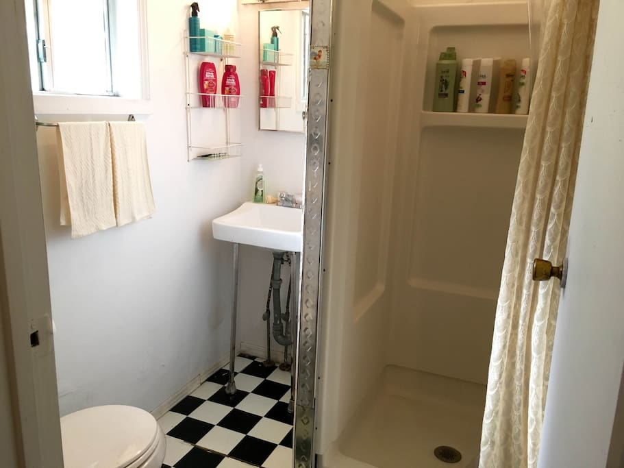 Private bath with shower, towels, travel essentials, soaps, shampoos and conditioners.