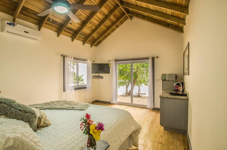 Spacious room with magnificent views, just steps away from the beach and your own swing!