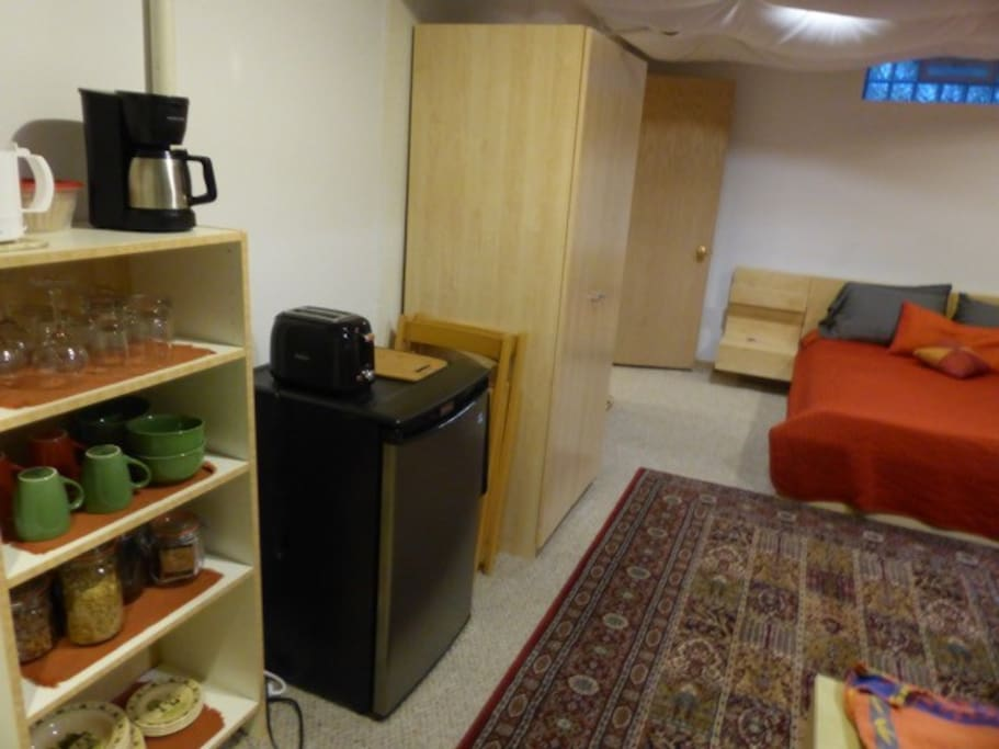 Bedroom shelving for continental breakfast and small refrigerator