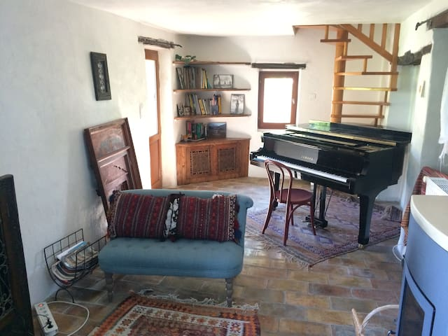 The living room with baby grand piano