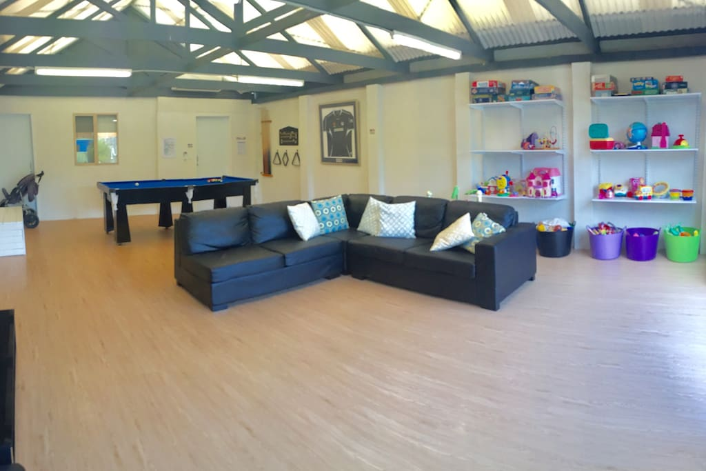 Rumpus room, large lounge, pool table, loads of toys and games.