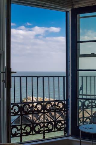 French doors with sea views & balcony