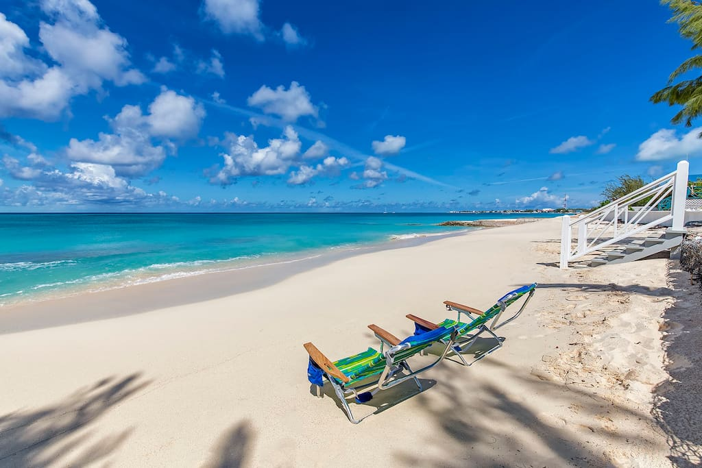 Relax on the beach and enjoy the soft sand and the warm waters of Grand Turk just outside your door.