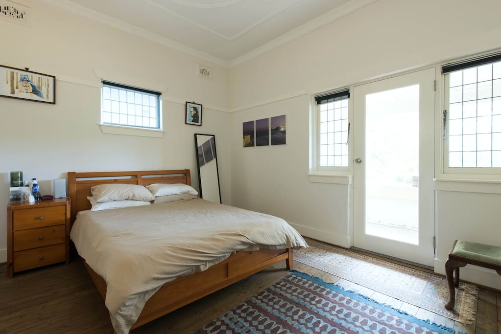 Large double master bedroom with a queen bed boasts plenty of wardrobe space for all your clothes