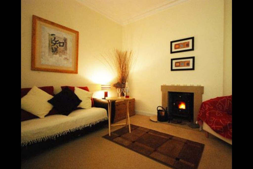 Living room with log burner in action.