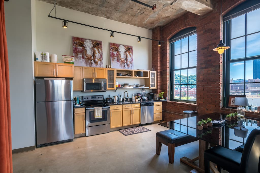 Open kitchen with views of the Strip District and Downtown Pittsburgh.