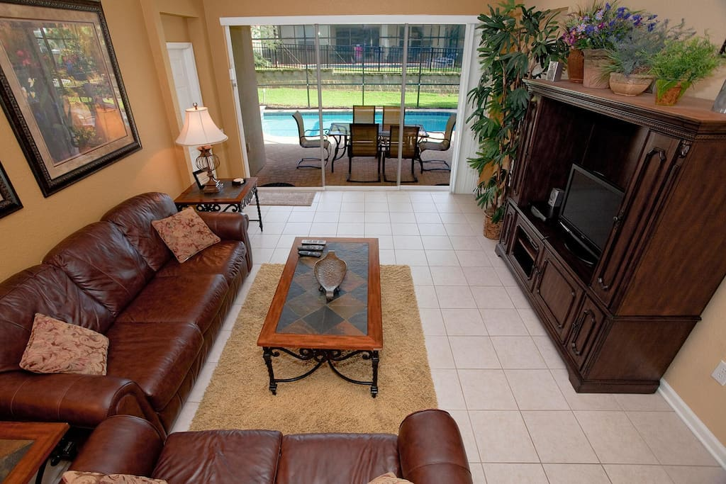 Spacious living area with 32-inch HDTV, DVD player, surround sound system and direct pool/patio access