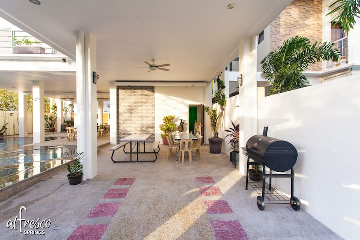 The entrance area doubles as a garage and seating area.   You are free to use the BBQ grill.
