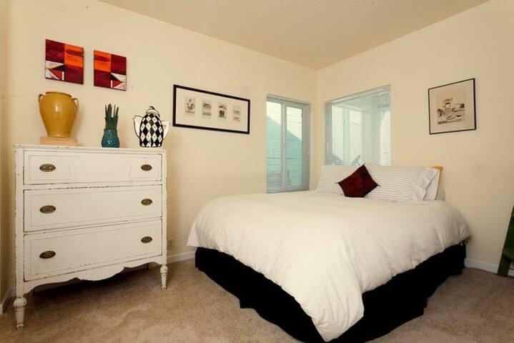 queen bedroom 1 w/ 2 closets and bath adjacent