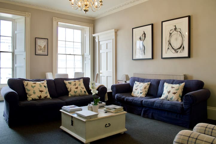 Large lounge with plenty of seating for an impressive period apartment