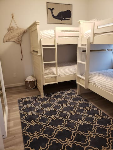 2nd bedroom sleeps 4 on two twin over twin bunks. New Serta mattresses on all beds.