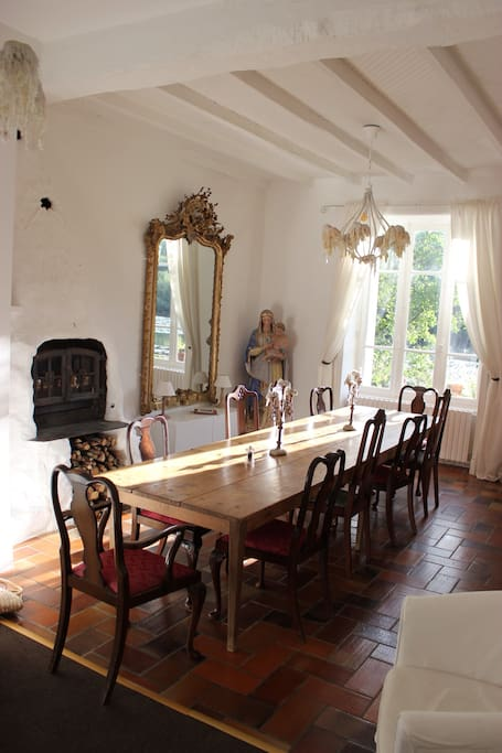 Dining Room with views into the lake. Open fire and table to seat 12. Sofa and easy chairs at the far end of the room.
