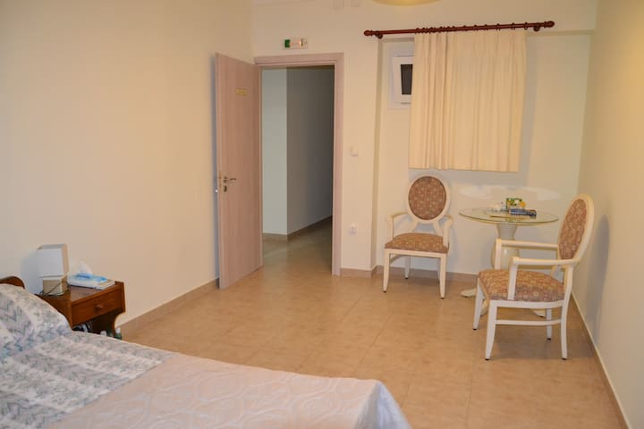 Skala apartments, Kefalonia Greece:  one of the bedrooms has narrow window overlooking to outside internal corridor