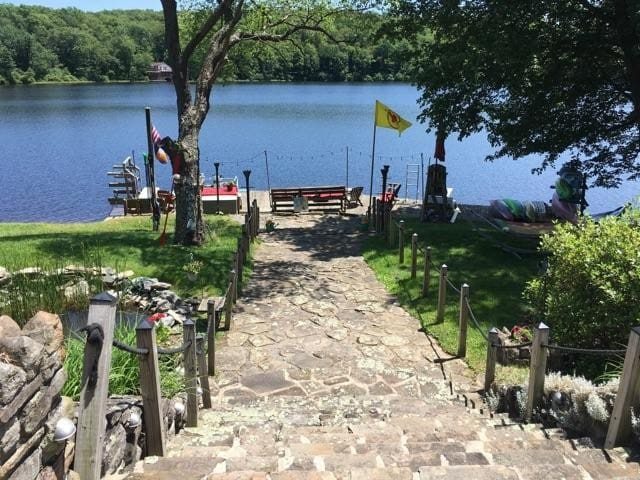 Stone steps to dock area. 10 boats plus wood fire pit