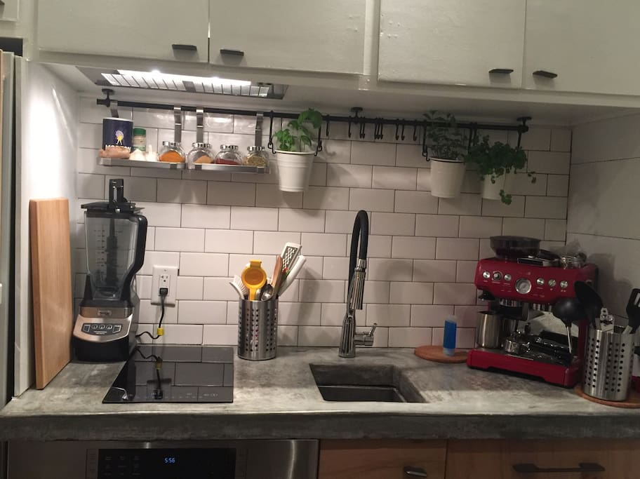 """Bosch Speed Oven and Refrigerator.  Induction cooktop and Fisher Paykel drawer in this """"tiny"""" kitchen."""