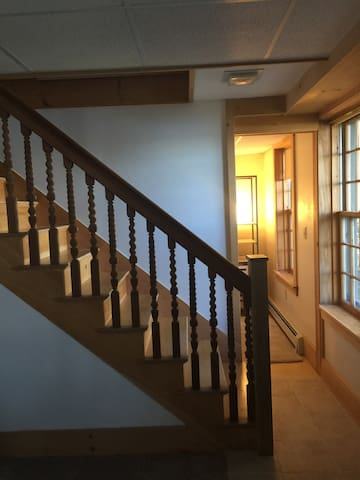 Stairs to lower level rooms