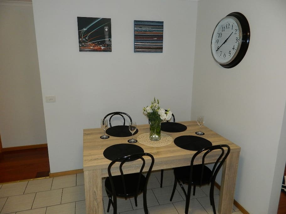 Comfortable dining area with natural light for 4 - 6 people.