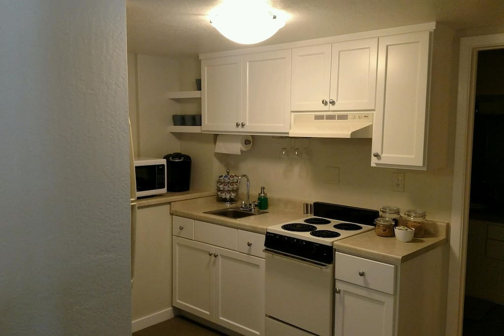 Kitchenette...stove, microwave and fully equipped with all necessary dishware, utensils and pots!