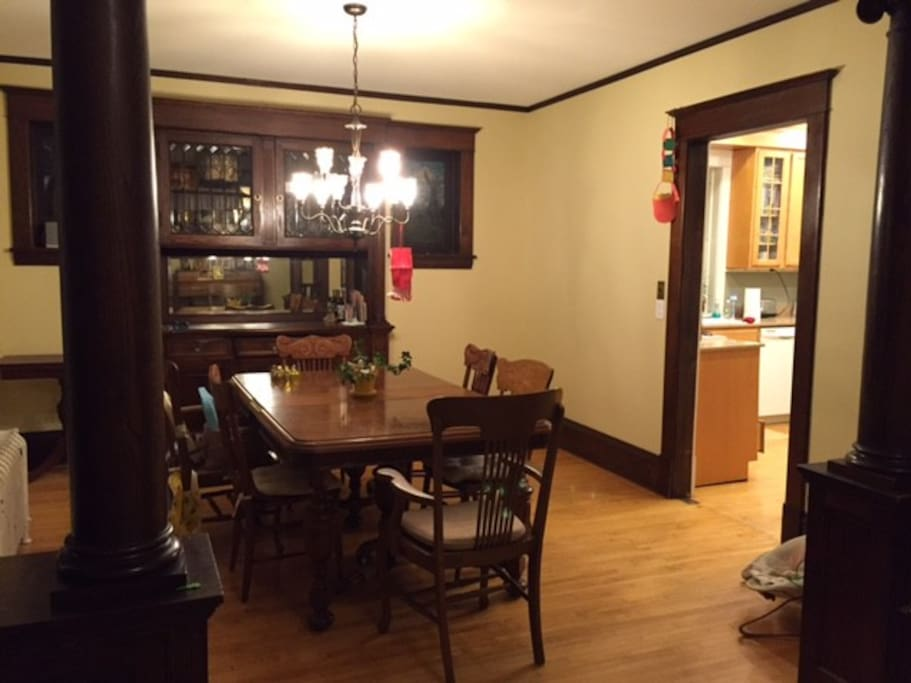 Dining room with built-in buffet and stained glass windows