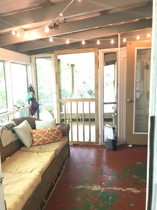 Screened in porch area with hammock available