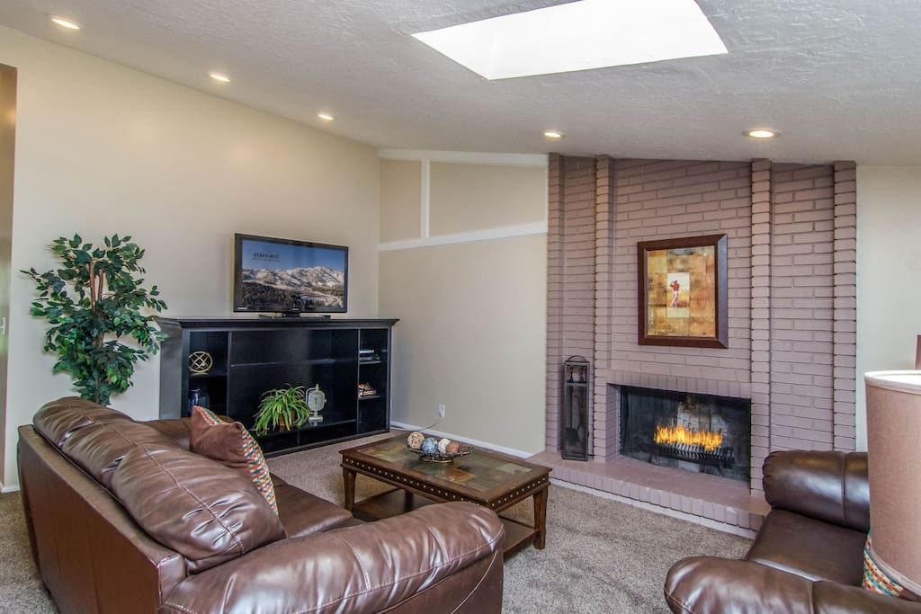 Comfortable seating, TV, and a fireplace