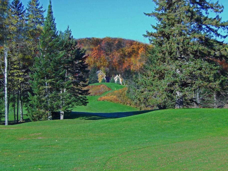 Golf course and mountain view from the front balcony. Across the street is golf course La Bete!
